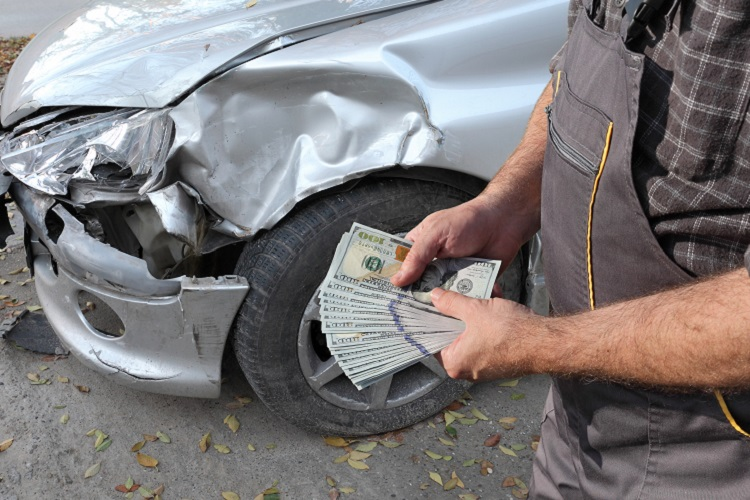 Damaged car inspection, male hands holding money, dollar banknotes, insurance agent or worker, mechanic